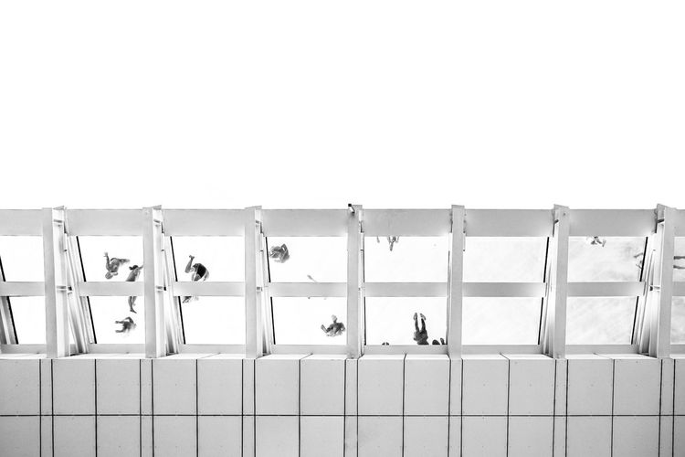 Row of chairs against white wall