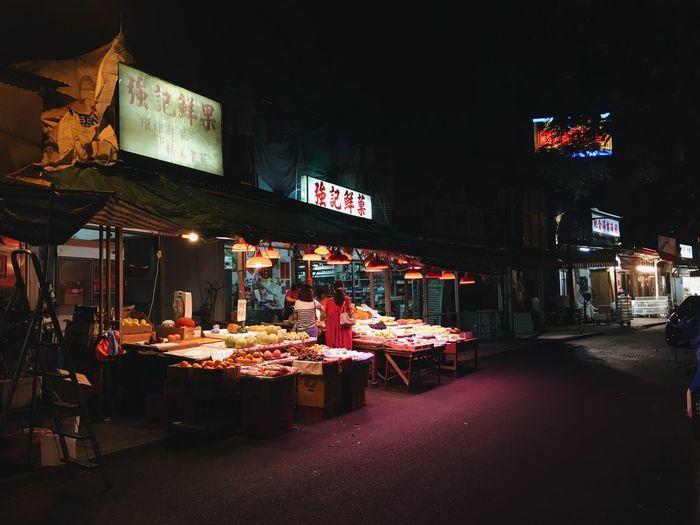 Illuminated market stall at night