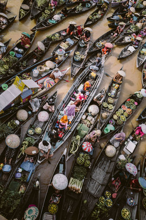 a family in the middle of floating market My Year My View Enjoy The New Normal Abundance Asian Culture Culture Day Full Frame High Angle View Large Group Of Objects Market Market Stall People River Traditional Festival Canoe The Street Photographer - 2017 EyeEm Awards The Photojournalist - 2017 EyeEm Awards Let's Go. Together. EyeEm Ready