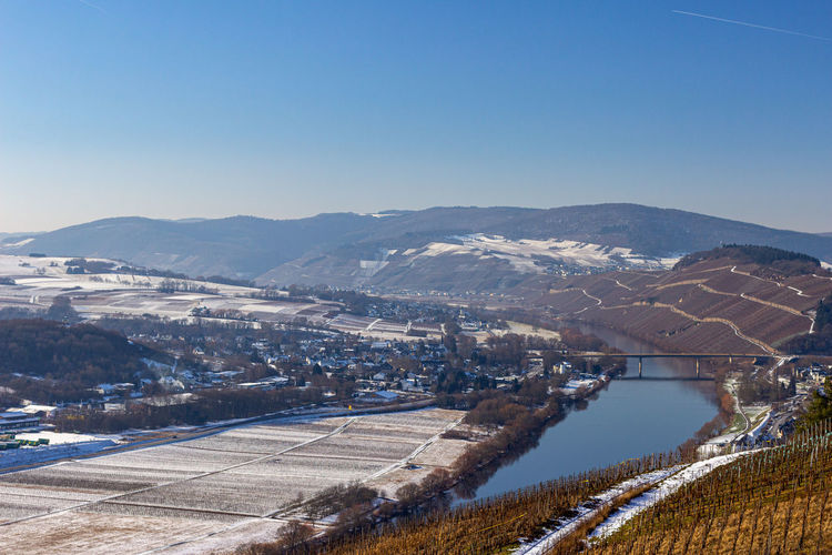 View on the valley of the river moselle, germany in winter with snow