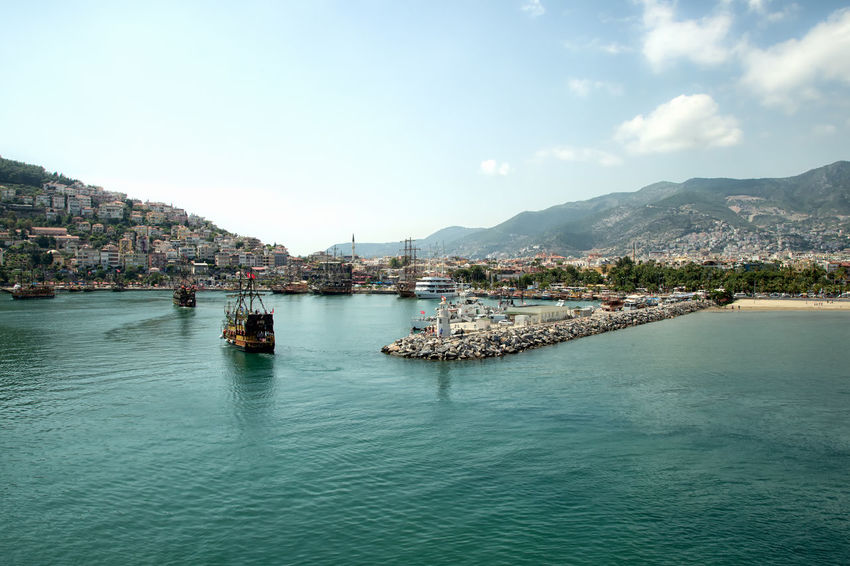 Alanya Coastline Alanya Blue Waters Mediterranean  Mediterranean Sea Turkey Architecture Bay Beauty In Nature Built Structure City Cloud - Sky Mode Of Transportation Mountain Mountain Range Nature Nautical Vessel Sailboat Scenics - Nature Sea Sky Transportation Travel Destinations Vacation Destination Water Waterfront