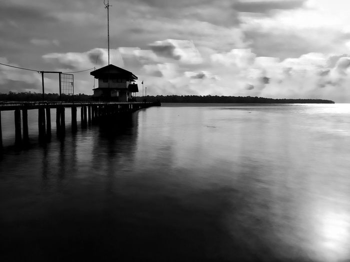 Witness of The Passage of Time Monochrome Blackandwhite Built Structure Cloud - Sky Architecture Sky Water Building Exterior Waterfront Nature Reflection No People Building Outdoors Dusk Sea Day Travel Destinations Connection