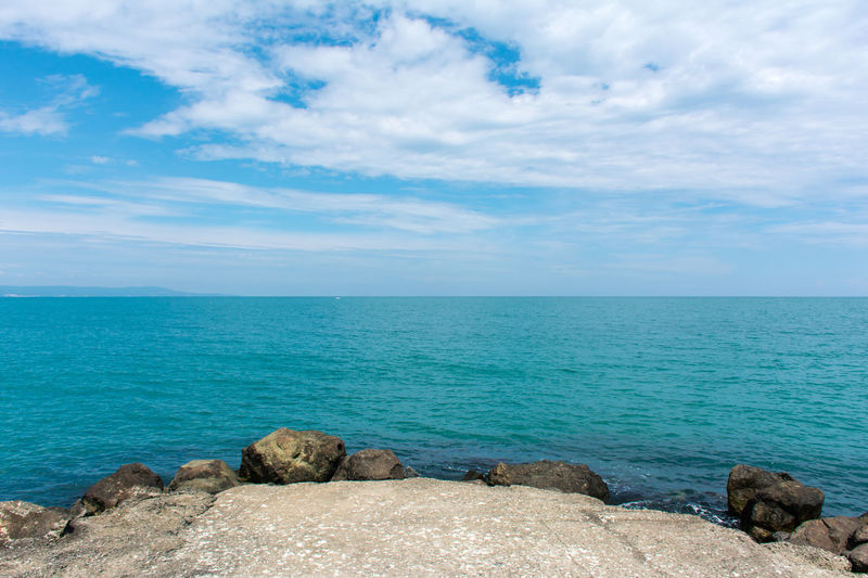 Beach Beauty In Nature Blue Cloud - Sky Day Horizon Over Water Horizontal Landscape Nature No People Outdoors Rock - Object Sand Scenics Sea Sky Social Issues Water