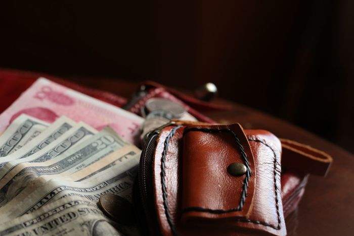 Holiday budgets concept Leather Bag Coin Pocket Hk USD Trip Payment Currency Rich Cash Still Life Indoors  No People Close-up Wealth Day