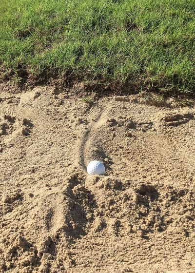 In the Bunker! Golf Round Sports Event  Sport Time Ball Sand Bunker Creativity Test Tricky Challenge Fun Golfer Golfing Sand Shot Plugged Bunker Shot Bunker Golf Ball Golf Course Golf Sport Sports Sand Day Field Mud No People High Angle View Grass Outdoors Beach