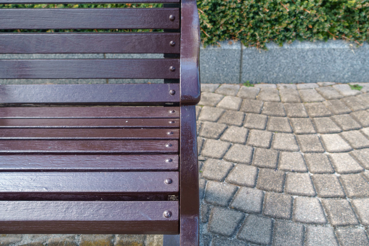 CLOSE-UP OF BENCH ON WOOD