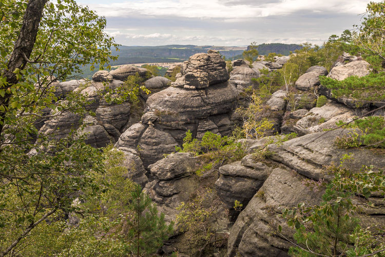 View of rock formation on landscape against sky