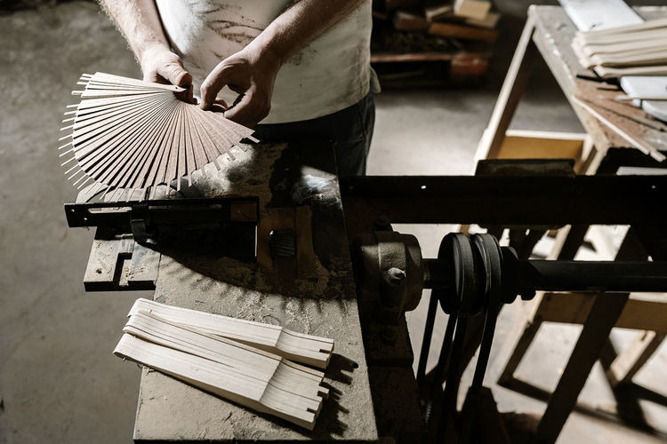 Low section of man working on table