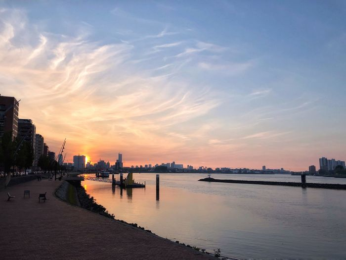 Sunset in Rotterdam Rotterdam Holland EyeEm Selects Water Sky Sunset Architecture Beauty In Nature Cloud - Sky Reflection Scenics - Nature Nature Orange Color Tranquility No People Built Structure Beach City Tranquil Scene Outdoors