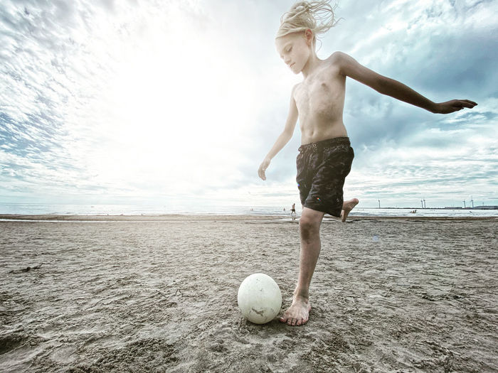 Full length of woman ball on beach