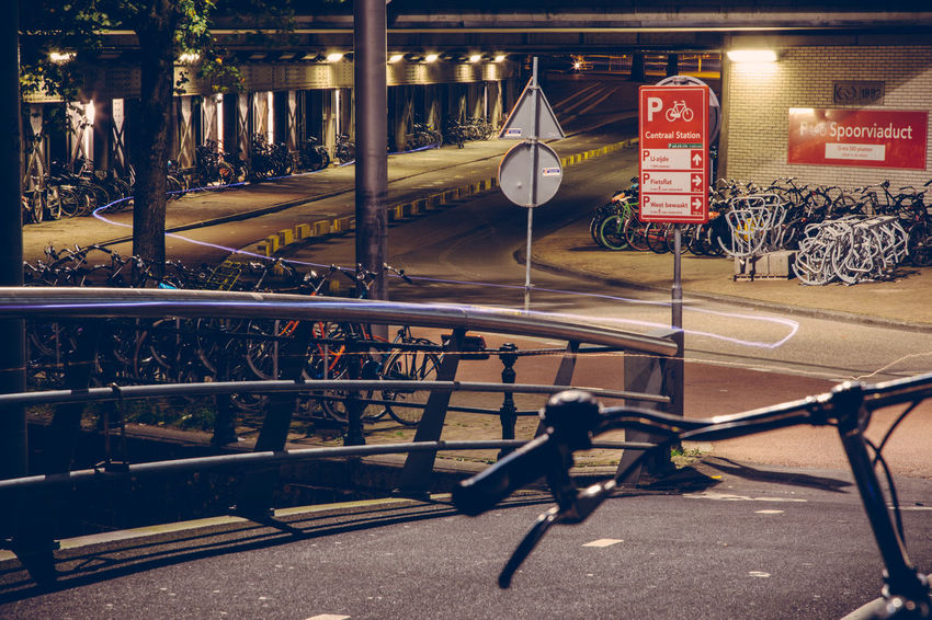 Light trail from a cyclist riding over the bridge Amsterdam Architecture Beautiful Bicycle City Holland Light Trails Long Exposure Moonlit Netherlands Night Night Photography Tunnel