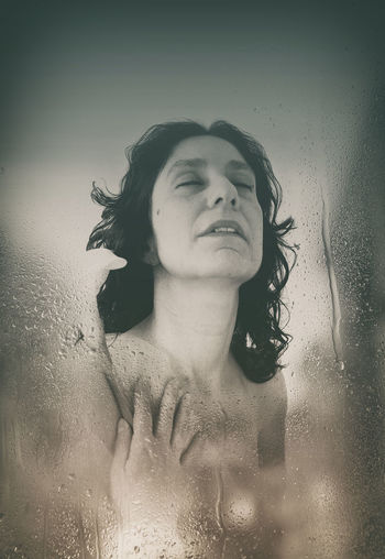 Portrait of woman with reflection in water