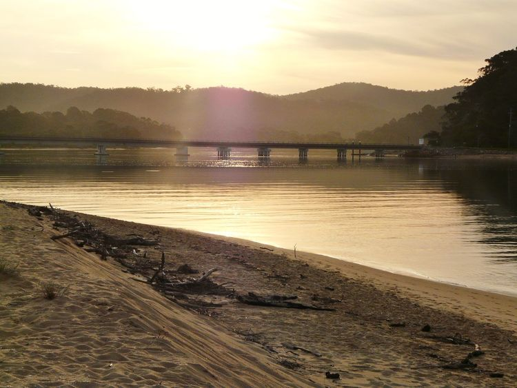 Australian Landscape Beauty In Nature Bridge - Man Made Structure Driftwood Golden Hour Idyllic Mogareeka Mountain Mountain Range Nature Nature No People Non-urban Scene Orange Color Outdoors The Great Outdoors - 2016 EyeEm Awards Scenics Serenity Sky South Coast NSW Sunset Tathra Tranquil Scene Tranquility Water