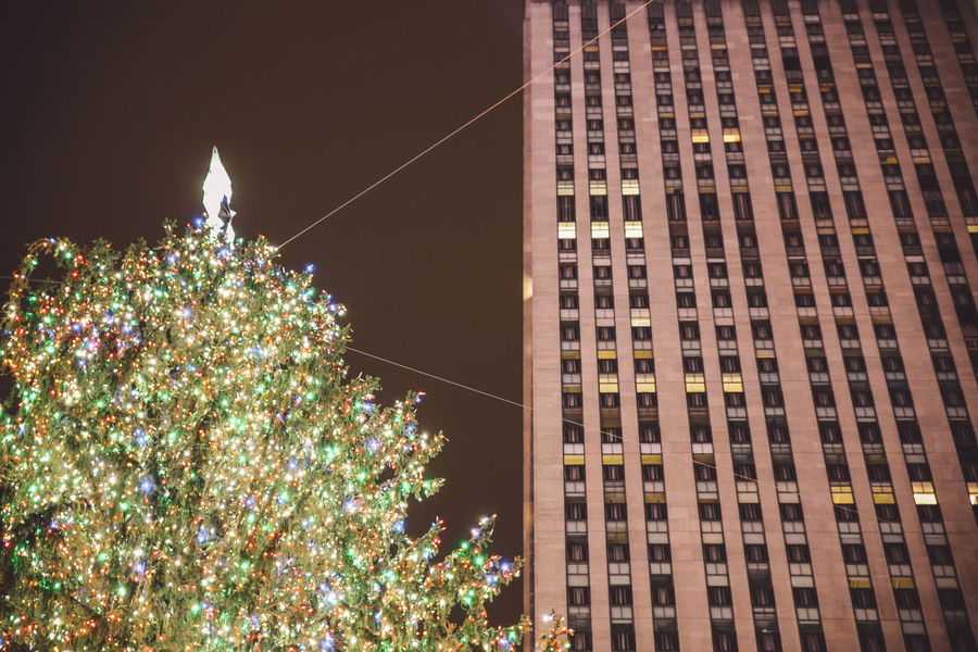 Architecture Building Exterior Built Structure Celebration Christmas Christmas Christmas Decoration Christmas Lights Christmas Tree City Decorations Holiday - Event Illuminated Lights Manhattan New York Night No People Outdoors Rockefeller Center Skyscraper Tradition Travel Destinations Tree Winter