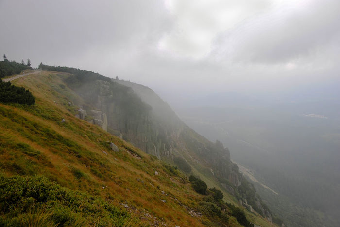 Mountain trail at the edge of the cliff Cloudy Freedom Hiking Karkonosze Misty Mountain Trail Mountain View Sudety Trekking Beauty In Nature Cliff Day Hiking Adventures Hiking Trail Landscape Love Mountains Mistery Atmosphere Mountain Mountains And Sky Nature No People Outdoors Rocks Slope Steep