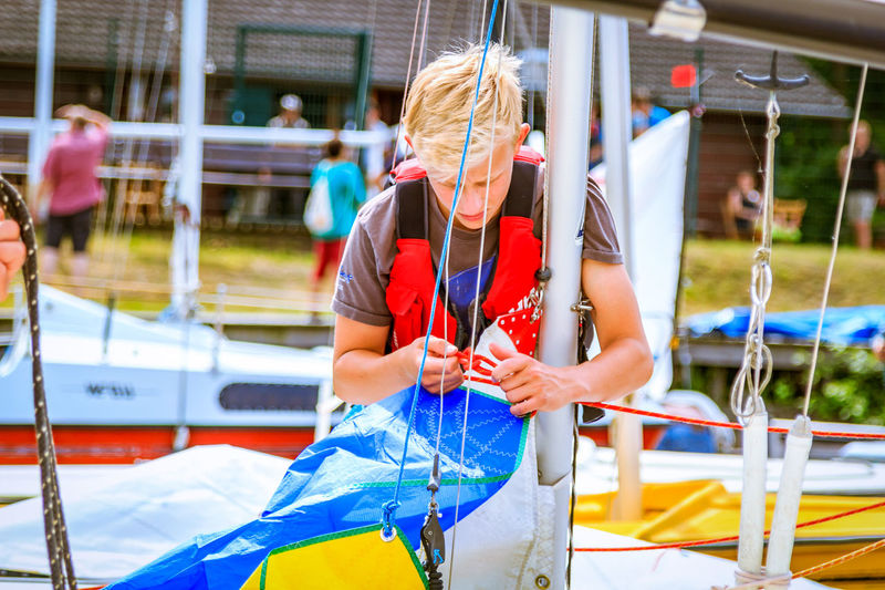 One Person Adult Adults Only People Outdoors Sport Real People Day Water Young Adult Sailing Boat Sailing Day Sailing Sailing Club Sailing Boat On Lake