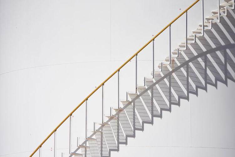 Metallic Staircase Against White Wall