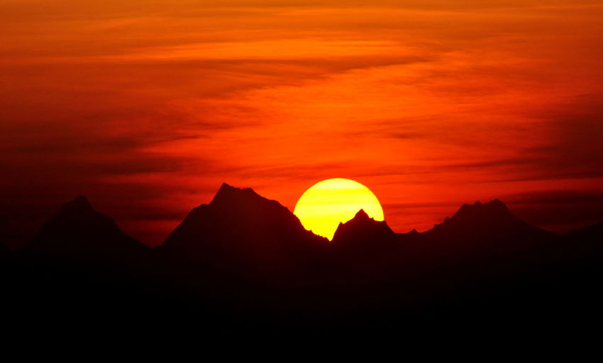 It is a beautiful photo of SUNRISE in Uthranchal state in India. It is northern India. Mountain