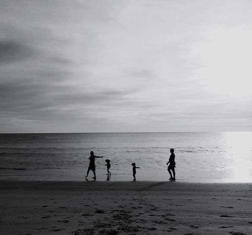 Family time. Beach Sea Sand Water Sky Nature Outdoors People Trip Shadow Beauty In Nature Blackandwhite Silouette And Shadows Silhouette