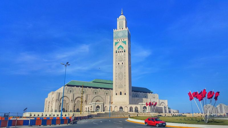 Casablanca, Morocco Flag Architecture Sky Built Structure Patriotism Building Exterior Day Blue Outdoors No People City Mosquee Hassan II