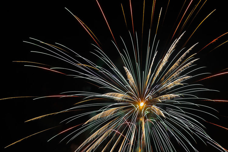Arts Culture And Entertainment Celebration Celebration Event Entertainment Event Firework Firework Display Glowing Illuminated Longexposurephotography Low Angle View Motion Multi Colored Night Night Photography Sparks