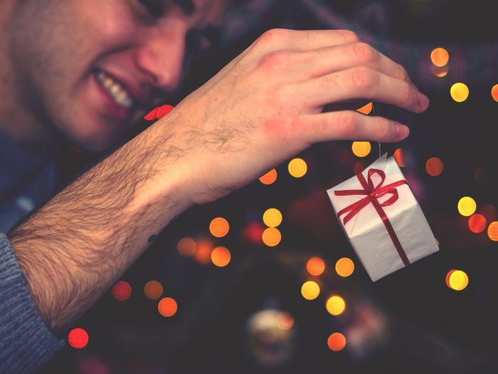 Close-up of man holding christmas decoration