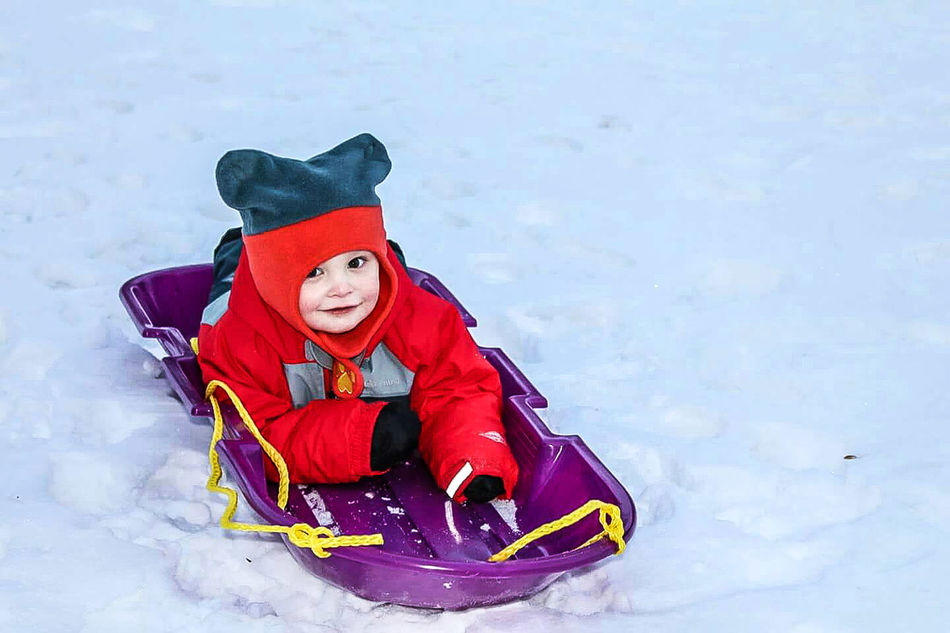 Winter Snow Sledding Child Cold Temperature Looking At Camera Snowflake Holiday - Event Childhood People Portrait Happiness Outdoors Tobogganing Showing Action Ski Slope Gear Holding On Tight Children Playing Ski Resort  Snow Resort Snow Sledding Adventure Motion Snowy Hills Snow Sports