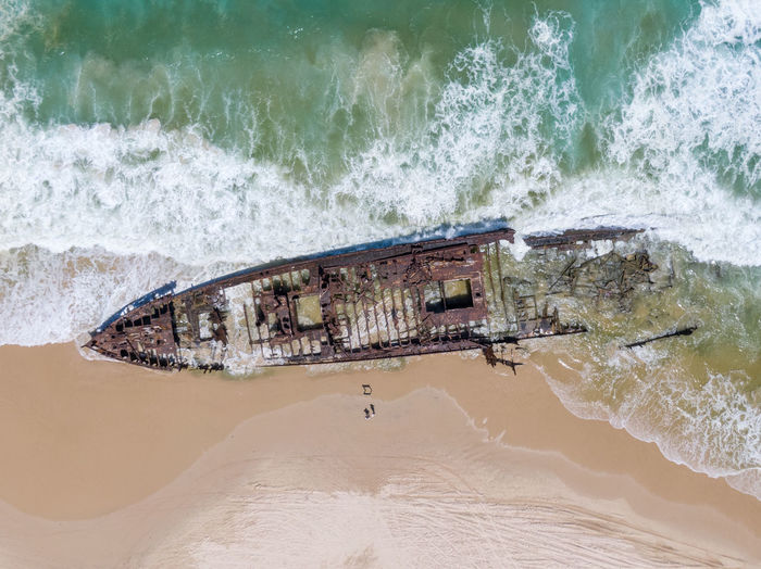 Aerial view of shipwreck at beach