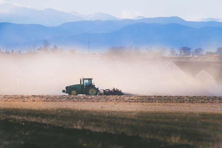 Field Land Fog Transportation Environment Agricultural Machinery Landscape Nature Mode Of Transportation Rural Scene Agriculture Land Vehicle No People Sky Scenics - Nature Plant Day Machinery Farm Combine Harvester Outdoors Dust