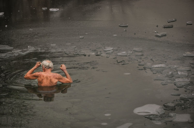 Day Ice Swimming Leisure Activity Lifestyles Men Nature One Person Outdoors People Real People Shirtless Water