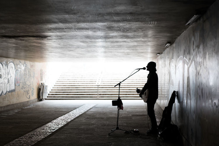 One Person One Man Only Standing People Adult Adults Only Silhouette Singer  Singing Urban The Street Photographer - 2017 EyeEm Awards Tunnel Passage Darkness And Light SONY A7ii BYOPaper! Occupation Minimalism Performing Streetphotography Street Performer Neighborhood Map Live For The Story Place Of Heart Breathing Space See The Light Business Stories Stories From The City Inner Power Analogue Sound