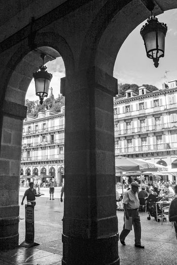 Architecture Built Structure Travel EyeEm Gallery Arch Archway City Life City Old Town Architectural Column Famous Place Sansebastian San Sebastian Donostia / San Sebastián Donosti  Blackandwhite Black And White Bnw_captures Bnw_collection Plazamayor Plaza Ayuntamiento Town Square Terrazas Christ Scupture People