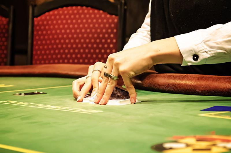 Casino dealer shuffling poker cards, women hands shuffling cards Cards Game Casino Gambling Cards Dealer Gambling Human Hand One Person Playing Poker Cards Poker Game Poker Table Shuffling Sport Women