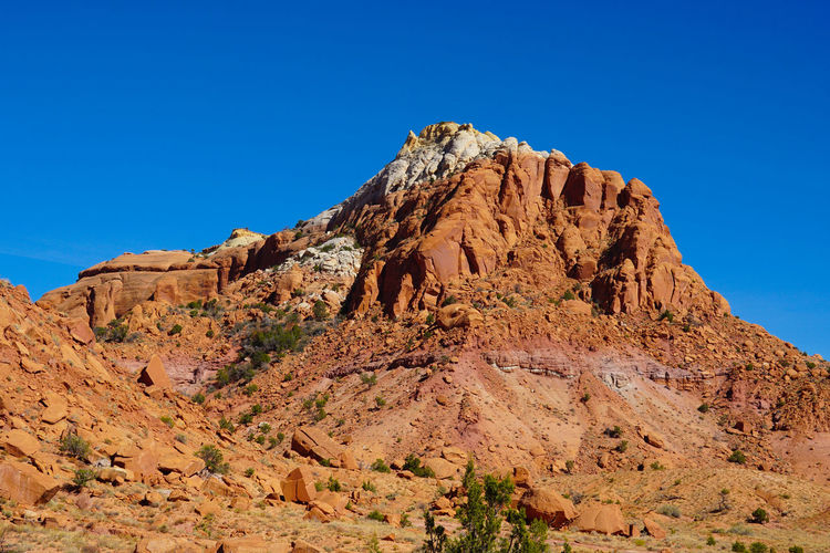 Rock formations against clear blue sky