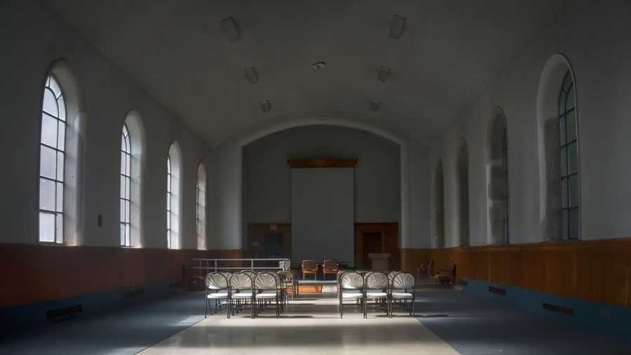 Rear view of chairs in empty interior