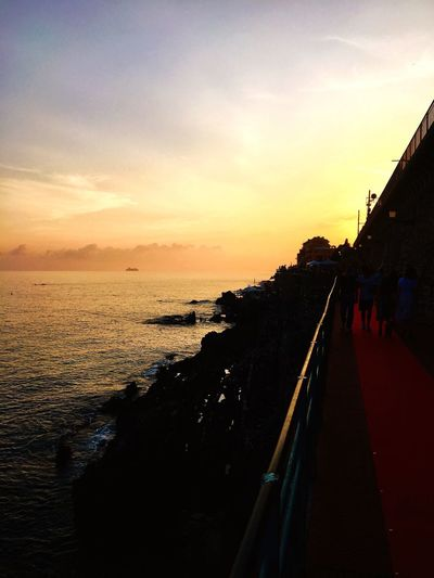Sunset Sky Sea Water Beach Beauty In Nature Scenics Walking Horizon Over Water Real People Nature Vacations Tranquility Lifestyles Outdoors Photography EyeEm Best Shots Panoramic Light Liguria Goaround Relaxing Redcarpet