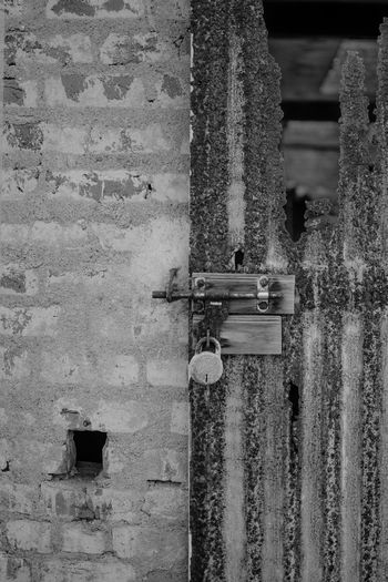 Locked out of hell Locked Out Rust Rusty Metal Gate Background Broken Doors Travel Photography Doors With Stories Black And White Light And Shadow
