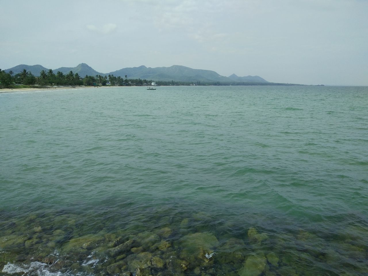 nature, scenics, beauty in nature, sea, water, tranquility, mountain, tranquil scene, outdoors, sky, waterfront, day, no people