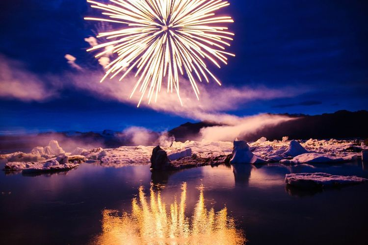 Night Reflection Celebration Illuminated Firework Display Firework - Man Made Object Party - Social Event Water Multi Colored Winter EyeEm Selects Reflection Exploding Arts Culture And Entertainment Celebration Event Shades Of Winter Ice Iceland