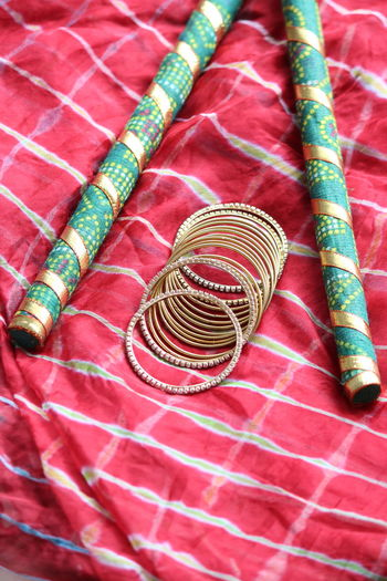 Fashion Green Color Navratri Indian Festival Red Bangle Close-up Dandiya Durgapuja Femanine Gold Bangles High Angle View Indoors  Jewelry Lehariya Saree Saree Still Life