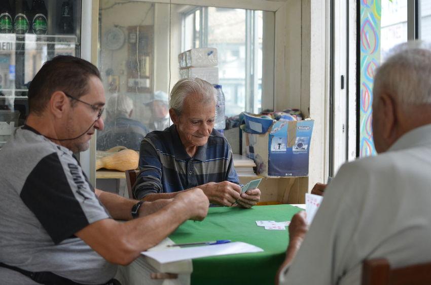 Adult Holding Mature Adult Men Real People Senior Adult Senior Men Sitting Table Togetherness
