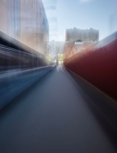 Architecture Building Exterior Built Structure City Transportation Motion The Way Forward Sky Building Diminishing Perspective No People Mode Of Transportation Road Blurred Motion Nature Motor Vehicle Day Land Vehicle Transparent Direction