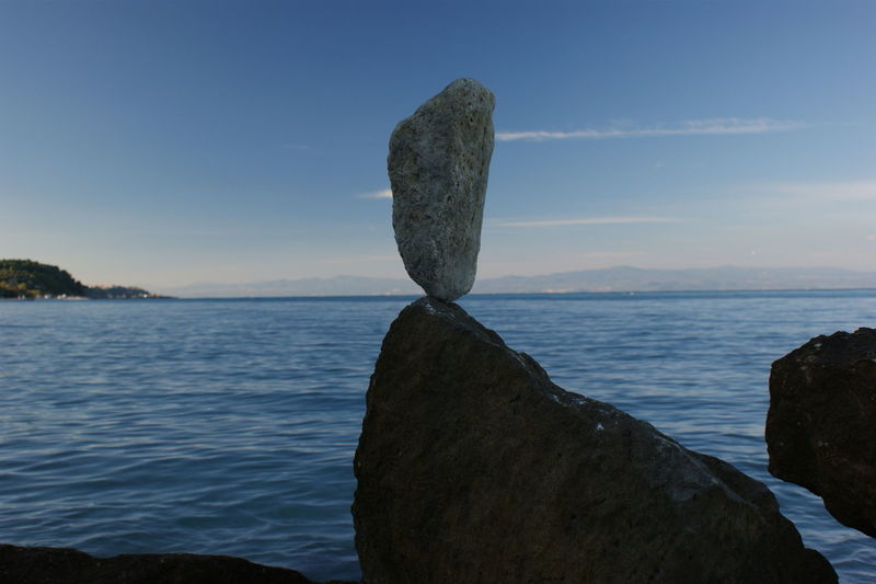 Stone - Object Water Blue Sky Sea Sky Scenics - Nature Tranquil Scene Tranquility Beauty In Nature Nature Rock Rock - Object No People Solid Land Blue Non-urban Scene Idyllic Outdoors Day Horizon