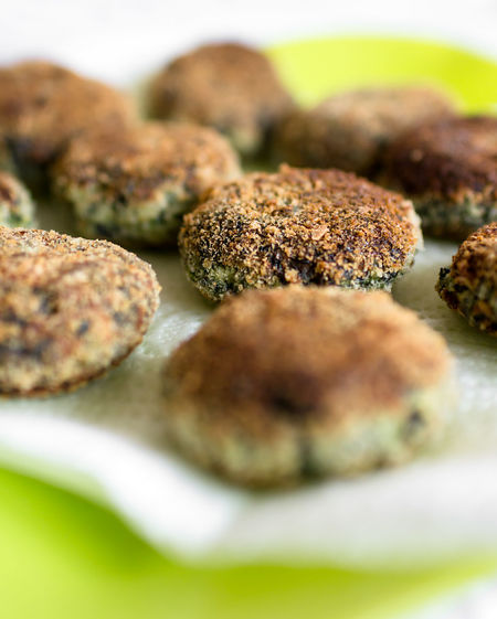 Vegetarian meatballs with spinach. Defocused blurry background. Cuisine Dinner Dish Green Homemade Lunch Meal Meatballs Rustic Appetizer Background Baked Balls Close-up Delicious Food Fresh Fried Gourmet Healthy Macro Minced Nutrition Parsley Recipe