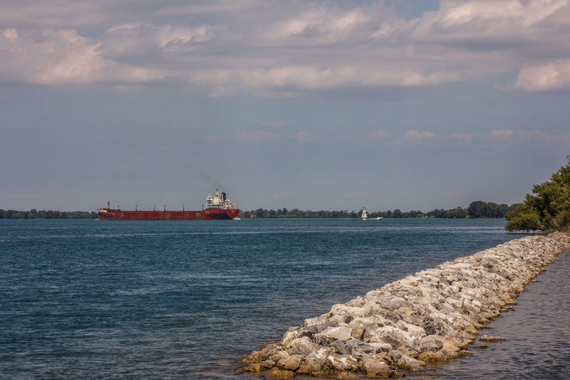 Freighter & dike Cargo Ship Detroit River Beauty In Nature Built Structure Channel Marker Cloud - Sky Dike Freighter Nautical Vessel No People Water Waterfront