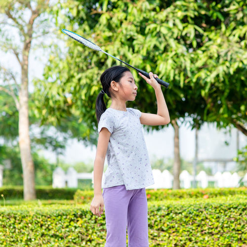 Girl playing badminton at park