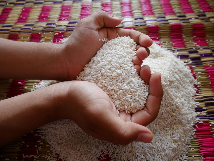 Heart of rice Agriculture Plant Seed Close-up Concept Day Eat Eating Healthy Faemer Food Food And Drink Grain Rice Heart Rice Horizon Over Water Human Body Part Human Hand Indoors  Lifestyles Lovely People Real People Rice Heart Rice Seeds Togetherness White Rice