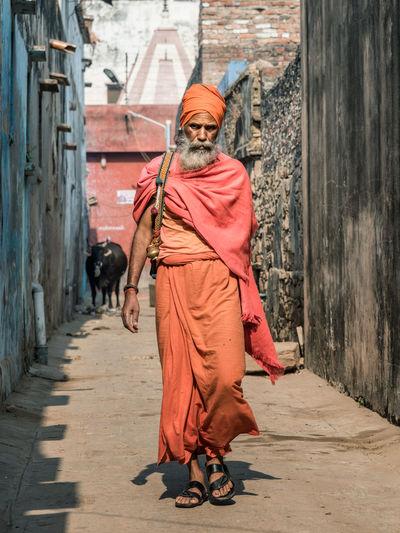 Full length of man walking on cross