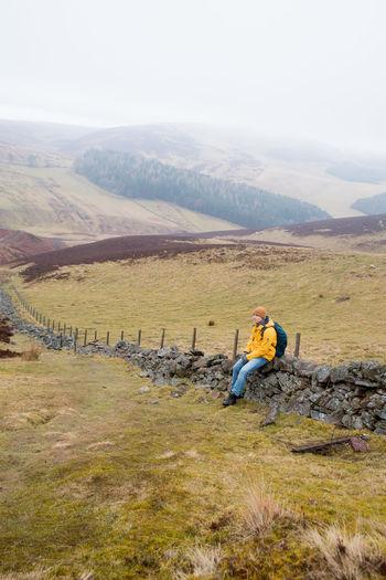 Full length of man on landscape against mountain range