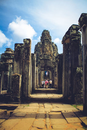 Visiting the ancient city of Angkor Wat in Cambodia. Adventure Ancient Ancient Civilization Architecture Built Structure Cloud - Sky Day History Leisure Activity Lifestyles Nature Old Ruin Outdoors Sky Travel